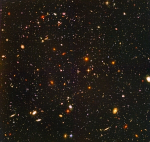 Hubble Ultra Deep Field image. Everything in this photo without rays is a galaxy, each with 100 billion stars or more.