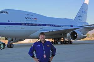 David V. Black standing in front of SOFIA: The Stratospheric Observatory for Infrared Astronomy