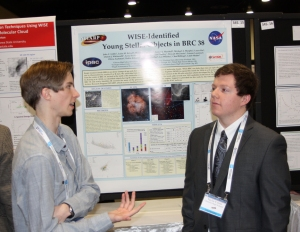Conner Laurence and another student explain their poster on finding YSOs in BRC 38.