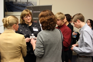 Dr. Meg Urry, President Elect for AAS, speaking with Wendi Lawrence and high school students at the State of the Universe briefing, Jan. 9, 2014.