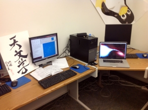 "A computer workstation in on the astronomy floor, with my notes and laptop. The sign at left says ""Astronomy (Tyan Wen Shwe)""  n Chinese."
