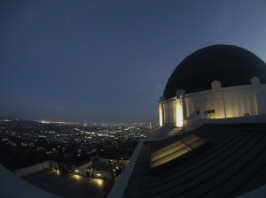The Dome of Griffith Observatory with the lights of Los Angeles in the background.