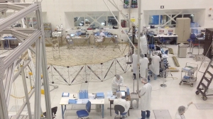 Technicians assembling the SMAP probe in the clean room at JPL.